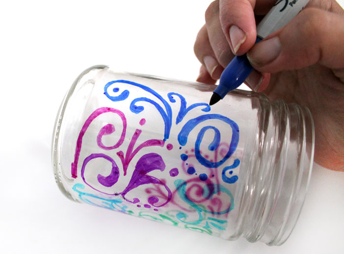 Relax with this adorable way to upcycle jars! This dots 'n doodles jar craft is a fun DIY project to help moms (or anyone) unwind.