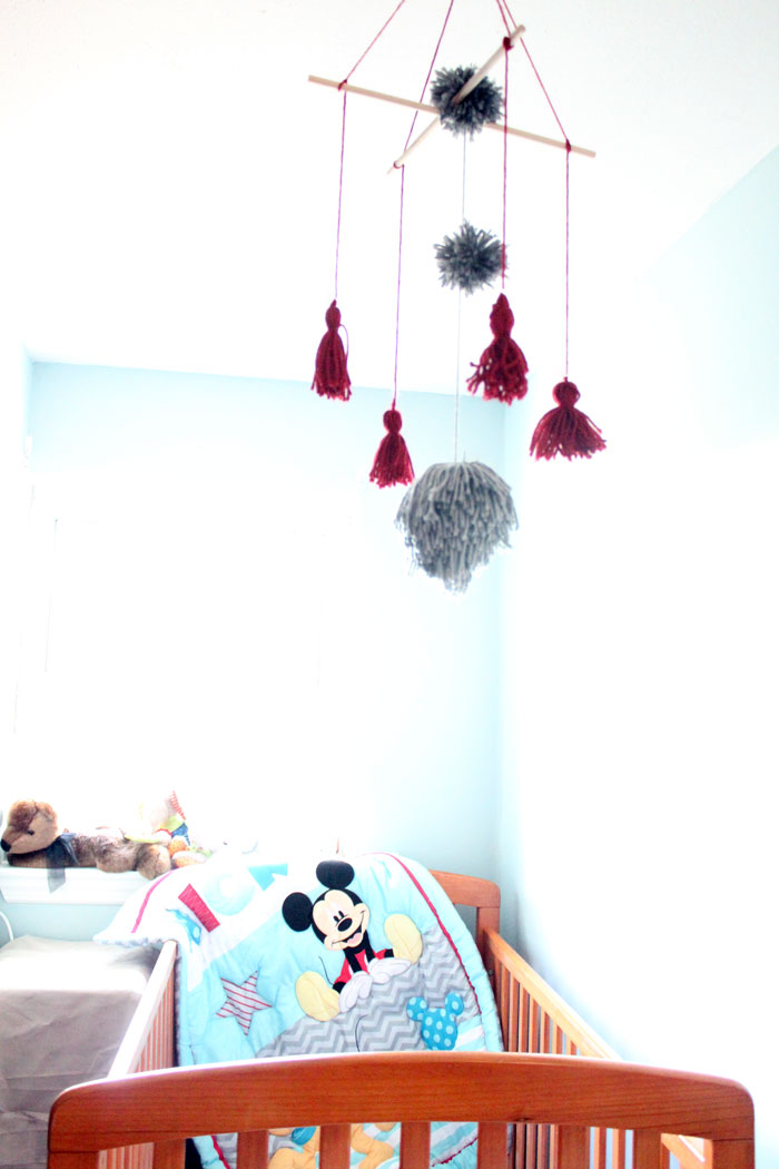 I love this precious tassel and pom pom baby mobile for my baby's nursery! Plus, this cheap and frugal nursery update with a Mickey Mouse theme is awesome!