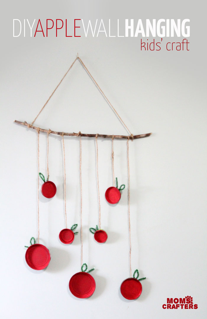 Make this beautiful apple wall hanging - an easy, pretty apple craft for kids! Make it for the Jewish High Holidays, or make it as an autumn craft. Either way, your kid will love this DIY wall art.