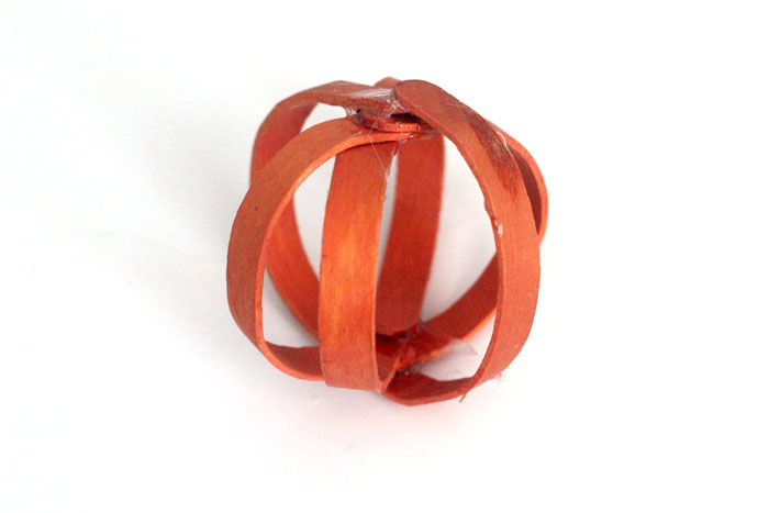 This bent craft stick pumpkin craft is so adorable - you'll want to make a lot for your Autumn or Halloween decor!