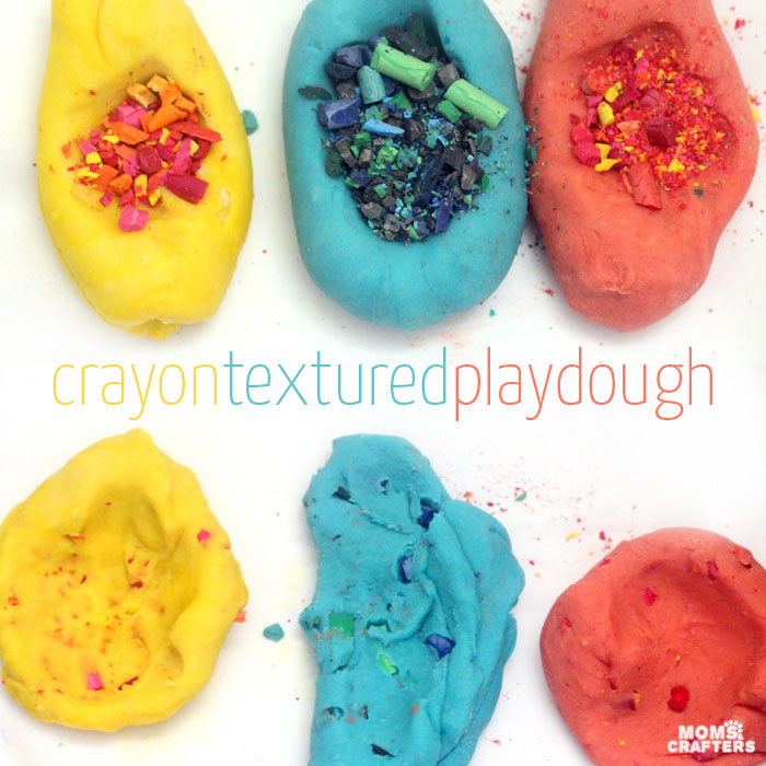 Make this super easy and fun crayon play dough recipe! Your child will love the extra sensory exploration. It's a fun crayon craft to use old crayons, and is an engaging kids activity as well!