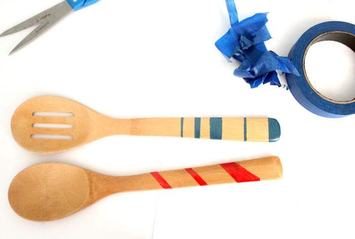 Click to find out the surprising material used to paint these wooden spoons! Painted wooden spoons are a great cheap DIY gift and easy craft. These are striped and durable - perfect for kitchen decor or cooking.