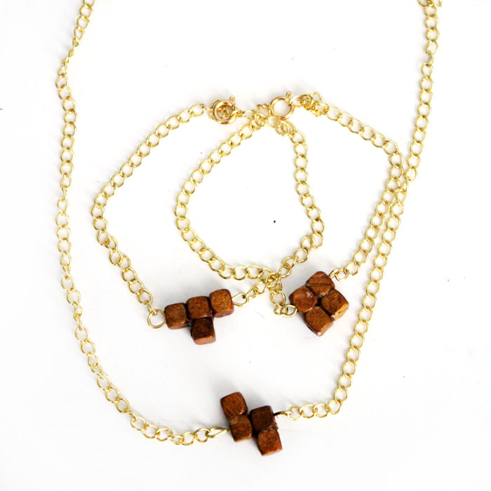 Jewelry making meets geekery! Make this adorable DIY Tetris Jewelry - inspired by Tetris pieces! It's an easy jewelry making craft for teens, tweens, gamers, or geeks, and makes a cheap DIY gift!