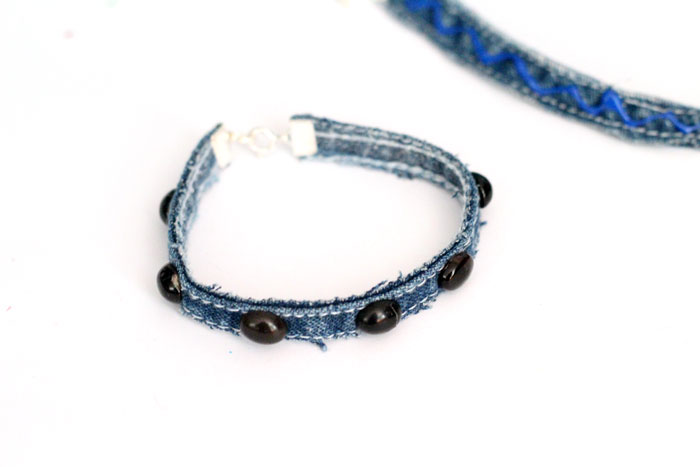 Make this simple no sew DIY denim bracelet by using recycled jeans! This easy jewelry making tutorial is a perfect. cool craft for teens and tweens.