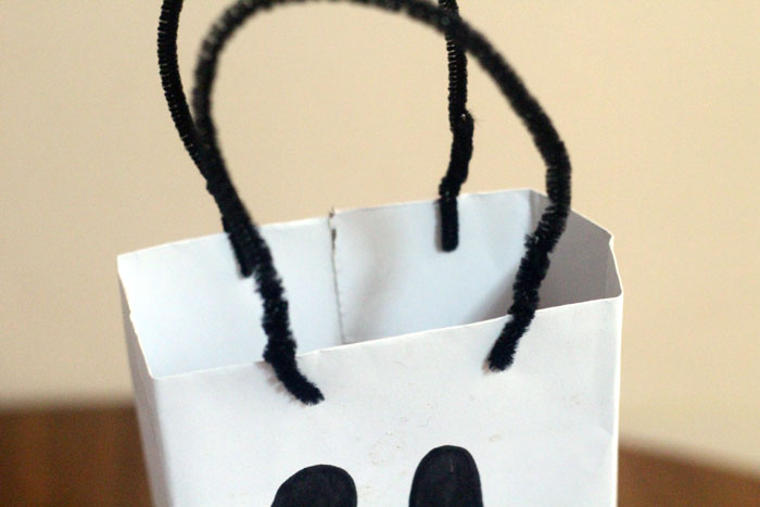 Make this spooky ghost treat bag to BOO a friend for Halloween! A simple craft for kids to get them involved, plus a free printable BOO card.
