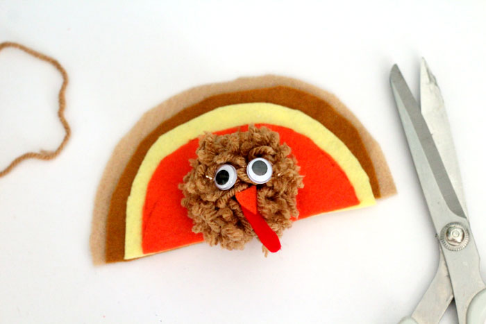 It's so easy to make this adorable pompom Thanksgiving turkey crafts for kids! It can be used as a toy, a napkin ring, a centerpiece, and other fun ideas. Love the DIY pom pom - I need to do it this autumn.