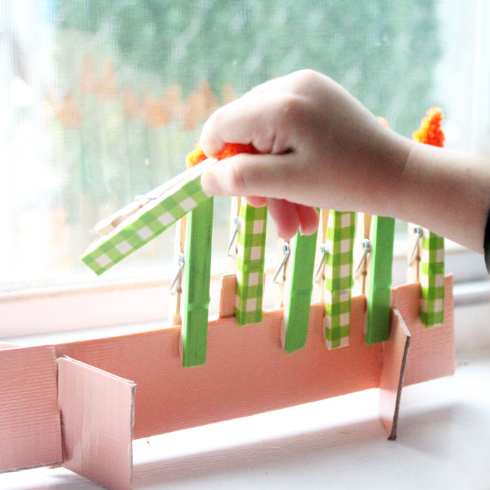 Make this adorable Hanukkah Menorah craft for kids. It's an adorable DIY toy menorah that I made for my toddler to light on Chanukah.