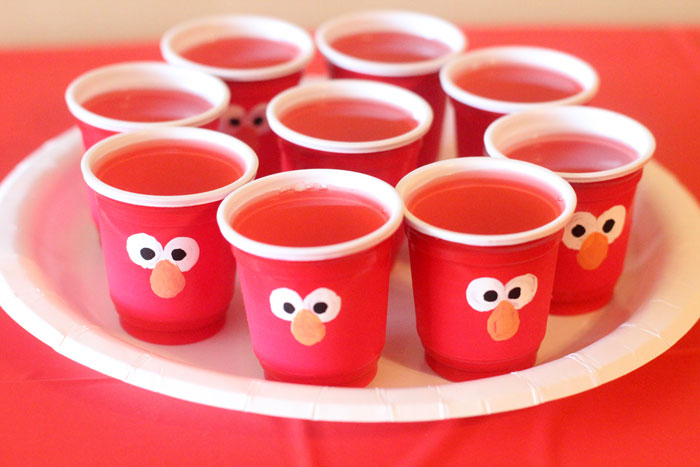 Elmo Jello cups | I LOVE these Elmo birthday party ideas - the tablescape is so cool! An Elmo theme is perfect for a first birthday party, or even second or third toddler birthdays. Check out this list of easy ideas.