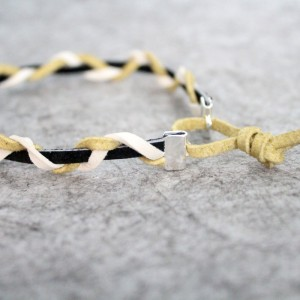 I love this braided leather bracelet - isn't it cool? It's a really cool craft for teen boys or girls, and also a great DIY gift idea for guys, or beginner jewelry making project.