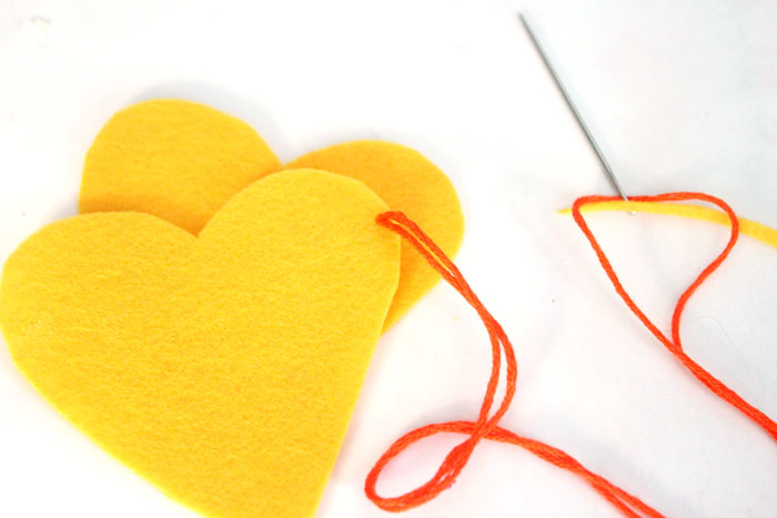 Make this adorable stitched felt craft for Valentine's day or any time of year! It includes a cute favor pouch version, and a plush heart keychain. IT's a great beginner sewing project for kids, teens, and tweens!