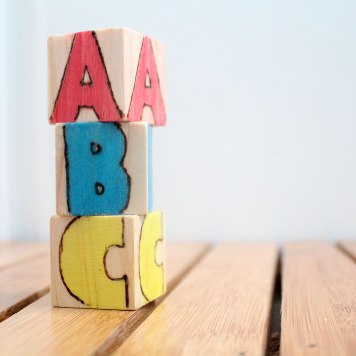 These colorful wooden alphabet blocks are surprisingly easy to make! They are so much fun to receive as a DIY baby gift and inexpensive to put together.