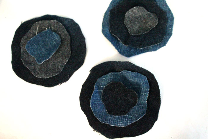 Make these super easy DIY recycled denim flowers. Perfect for making DIY accessories like headbands or hair clips, but I used it to update an old onesie. It's also a great way to upcycle and repurpose old jeans and a perfect craft for teens!