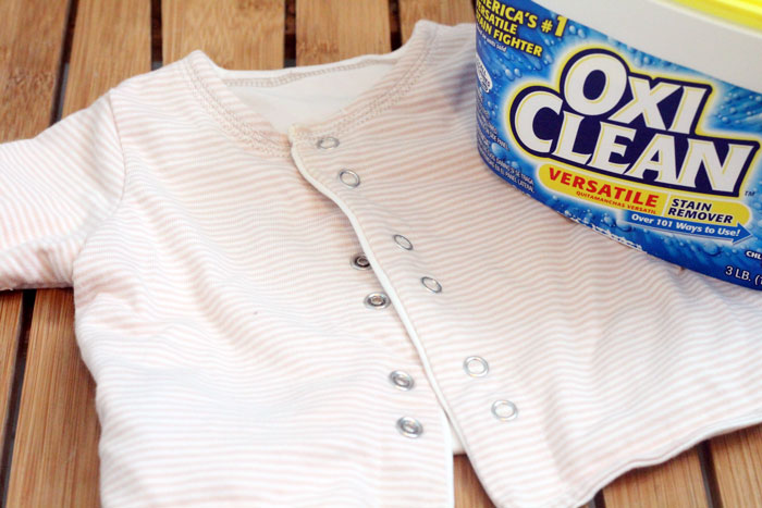 What do you do with old baby clothing? Here are 5 precious keepsakes to make from baby clothing, plus some tips for removing the stains before you do so!