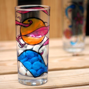 These DIY painted glasses are so cool - made using free printable adult coloring pages! They are an amazing DIY gift - they look beautiful and are dishwasher safe.