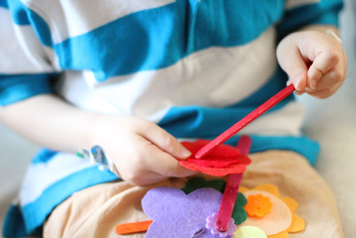 The easiest DIY fine motor toy to make for toddlers and preschoolers! I love these color-matching flowers - a great activity for my toddler to learn and practice colors and fine motor skills at the same time.