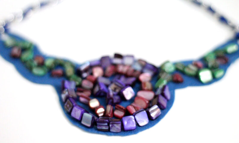 Make a beautiful DIY bib necklace with a pretty mosaic pattern. You can freeform or use symmetrical patterns on this fun jewelry making craft that's perfect for Spring, or any time you want to dress up a plain tee. It's so easy!