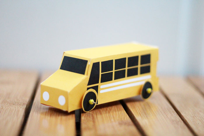 Grab these free printable school bus treat boxes for free! They include pillow box and a 3D bus that also makes a great toy. Perfect for back to school parties, transportation themed birthday party, or even as a gift box to thank a bus driver before school ends!