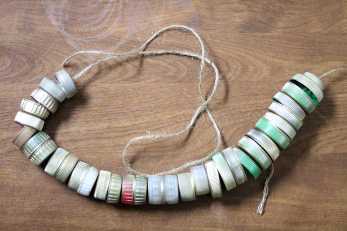 turn your recycling bin into a fun toy! Make a bottle cap rattlesnake craft for your little ones to play with - it actually rattles! This upcycled craft is a fun way to use up your bottle caps and a cute DIY toy idea.