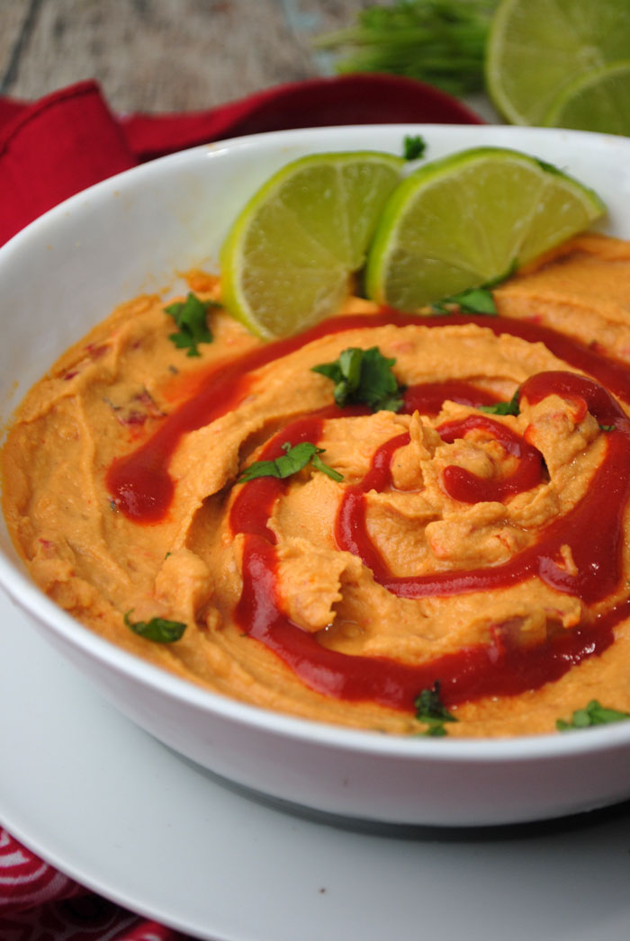 Make this delicious sriracha lime hummus recipe - a dip recipe with a kick! It's totally kid friendly and beautiful to display.