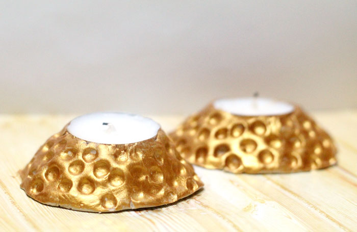 These beautiful faux hammered metal candle holders are stunning - and so easy to make! You don't need to be a pro to give this easy craft and DIY gift idea a whirl. Make DIY clay candle holders using a very specific clay that will work for this craft idea.