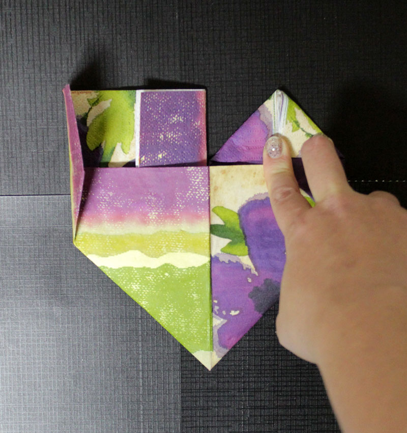 This heart napkin fold tutorial is perfect for Valentine's day, but it's also great for any time you want to set a romantic table, or just for fun! It's a great party idea, for anniversaries, for valentine's day, or for a spouse's birthday party.