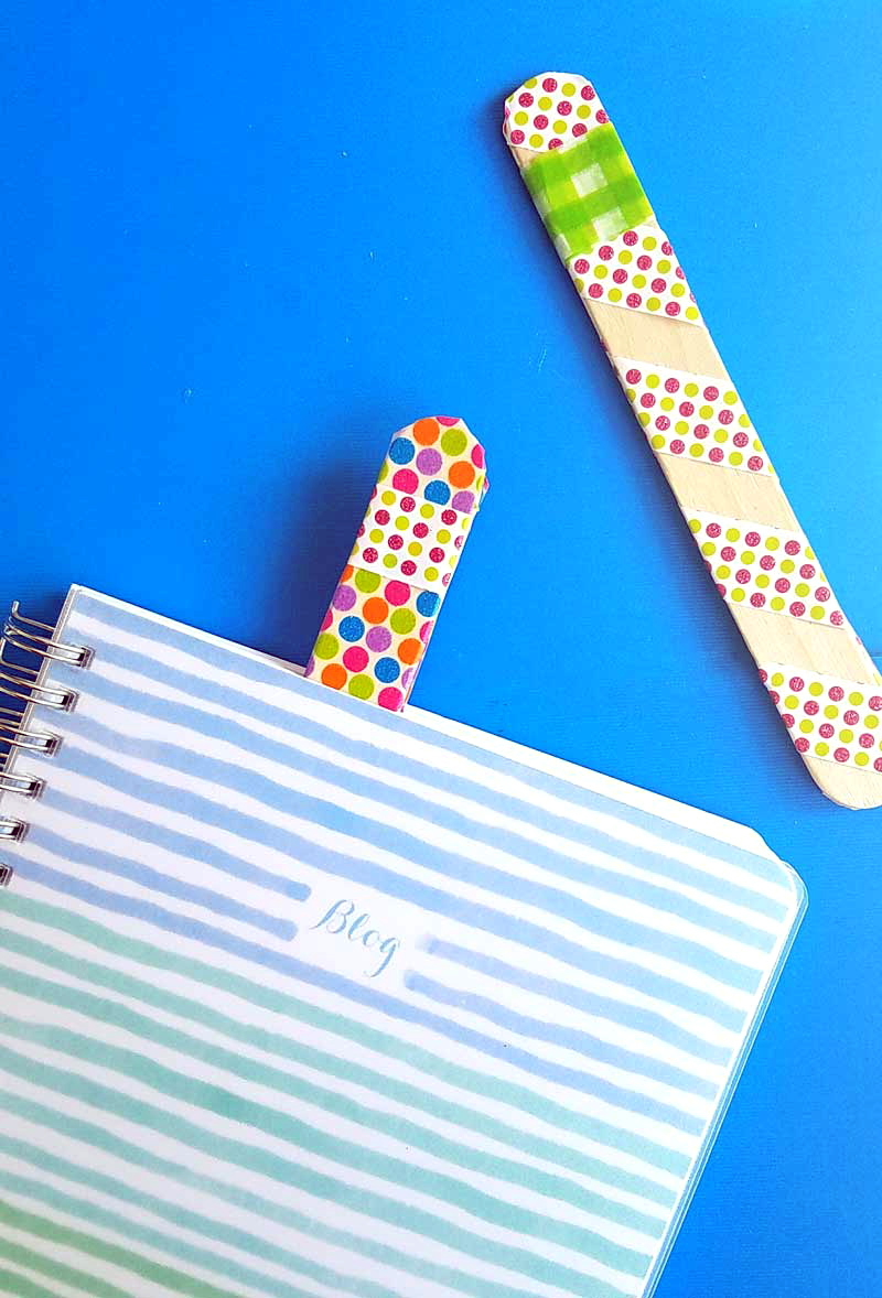 Make some fun DIY bookmarks that actually stay in place - using two fun methods! The craft stick bookmarks are a fun popsicle stick craft for kids of all ages - from toddler to teen!