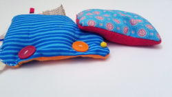 This easy DIY sensory toy is a fun beginner sewing project and DIY toy for toddlers and preschoolers. It's a weighted toy to help children with SPD, autism, or typical sensory input needs calm down, and an amazing easy calming tool for moms to create. You'll love this simple sewing craft for moms.