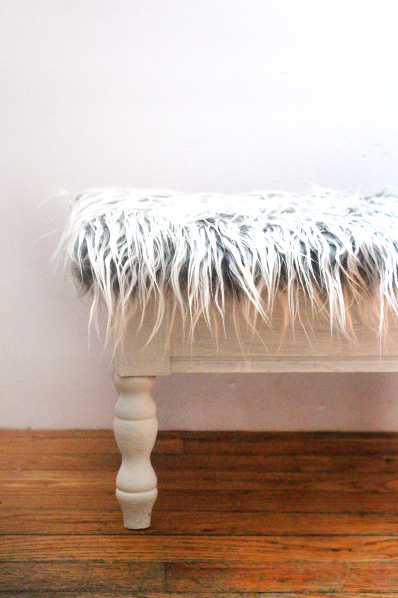 I love this DIY faux fur stool makeover from a flea market find! This ugly vintage sewing stool is transformed into beautiful DIY home decor for the craft room in under half an hour!