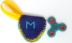 Make this DIY fidget spinner case to protect your fidget toy and keep it a bit farther out of reach of babies! It's an easy beginner felt sewing project that an adult or a child can make, plus it has a built in zipper fidget too! Free template / pattern included.