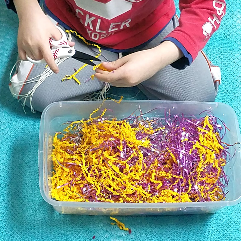 A cutting practice sensory bin that's a perfect way to entertain your preschooler and drink that coffee! This occupational therapy idea and scissors practice activity for preschoolers is perfect for preparing for kindergarten, or just to keep young kids busy.