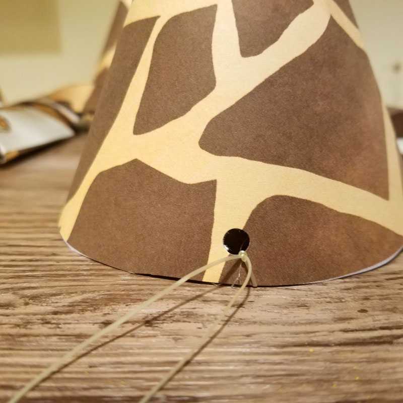 You'll love this giraffe birthday hat - including a free printable version! It's perfect for your giraffe birthday theme, or a jugle themed birthday party, or even a safari theme! It also includes a fun idea for a first birthday party theme for boys.