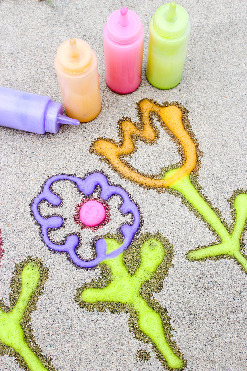 Make super easy foamy sidewalk paint - an awesome liquid sidewalk chalk recipe that's perfect for cold weather too! This outdoor art activity for kids is super easy and inexpensive, can be done in the winter, can be used to paint snow, can be carried over as a spring or summer activity too - basically, you can do anything with it!
