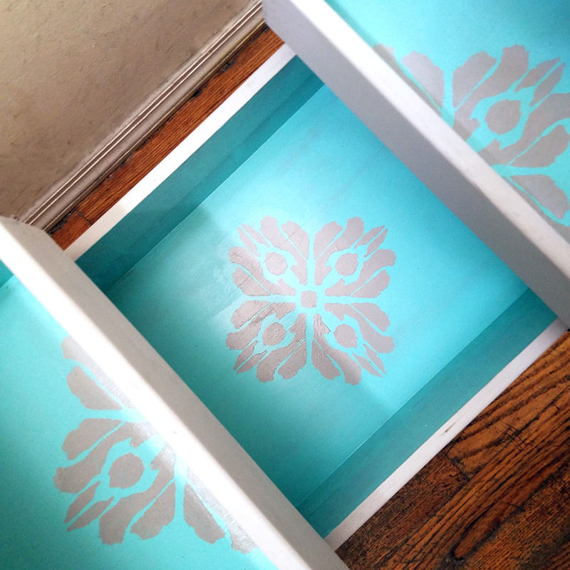 "Open up for a cool surprise! Update a vintage sewing box with this cool DIY makeover using stencils. The top says ""create"" and there are beautiful patterns inside - you simply won't believe that this was a flea market find! One of my favorite thrift store makeovers and trash to treasure DIY projects ever, and perfect for craft room organization."