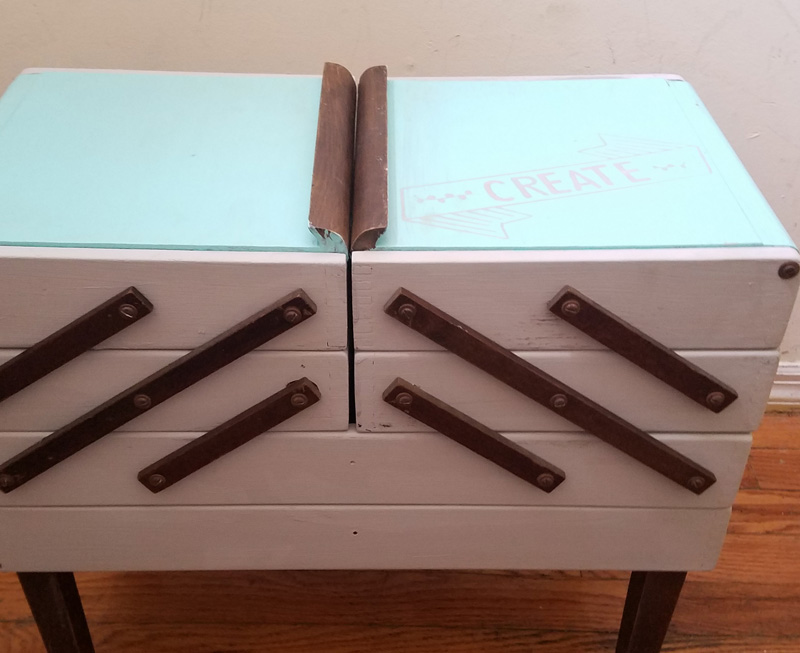 Open up for a cool surprise! Update a vintage sewing box with this cool DIY makeover using stencils. The top says
