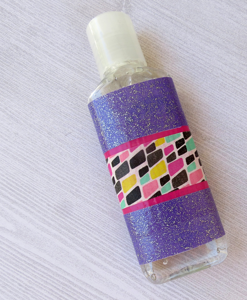 Why washi-tape bomb a hand sanitizer bottle, you ask? These make the most adorable baby shower favors! This washi tape craft is a quick and easy solution for a baby shower craft for a baby boy or girl, and makes a perfect addition to a new mom basket.