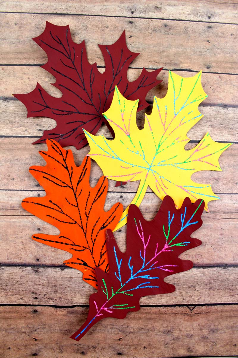 Make this beautiful scratch art fall leaf craft - a beautiful and easy autumn paper craft for kids! Includes a free printable template.