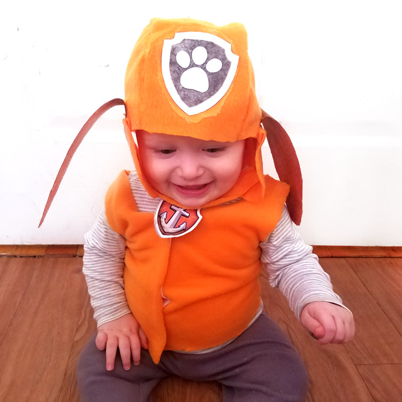 Make this easy BABY ZUMA PAW Patrol costume for toddlers or babies! It's an easy no-sew costume to create and great for a family costume theme.