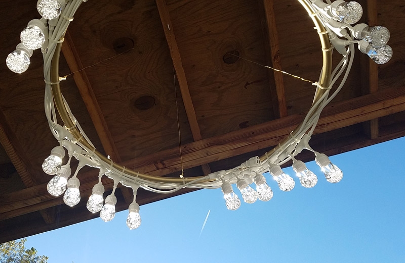 Make a beautiful DIY outdoor chandelier - beautiful and functional patio decor! It's a great way to update your outdoor space.