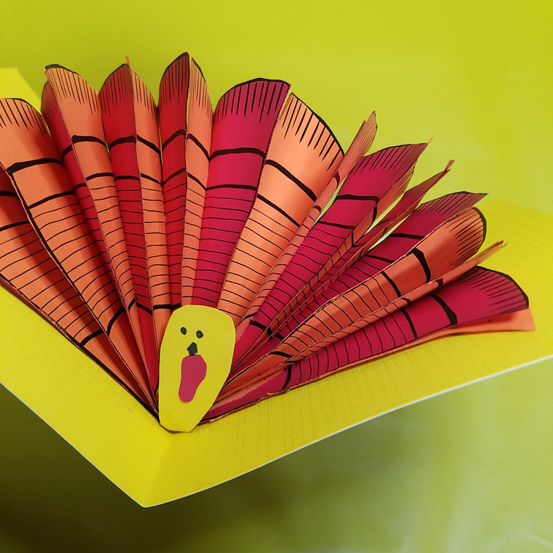 These free printable turkey feathers are so versatile and perfect for yoru Thanksgiving crafts for adults and for kids! You can make a pop up card with them or any Thanksgiving turkey paper craft