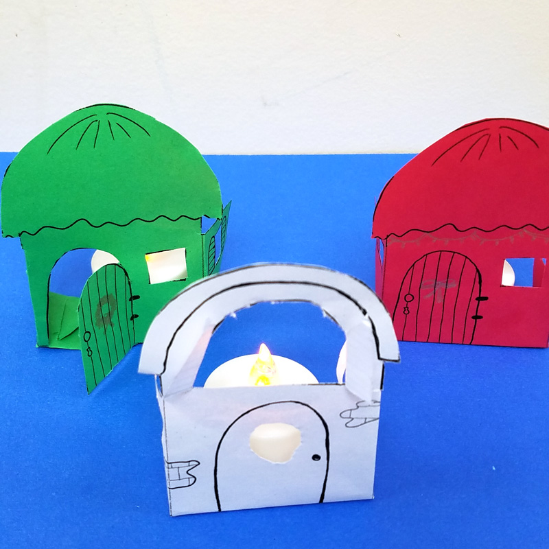 Make these super easy Christmas paper houses - a free printable and a cool paper craft for teens, tweens, and adults.
