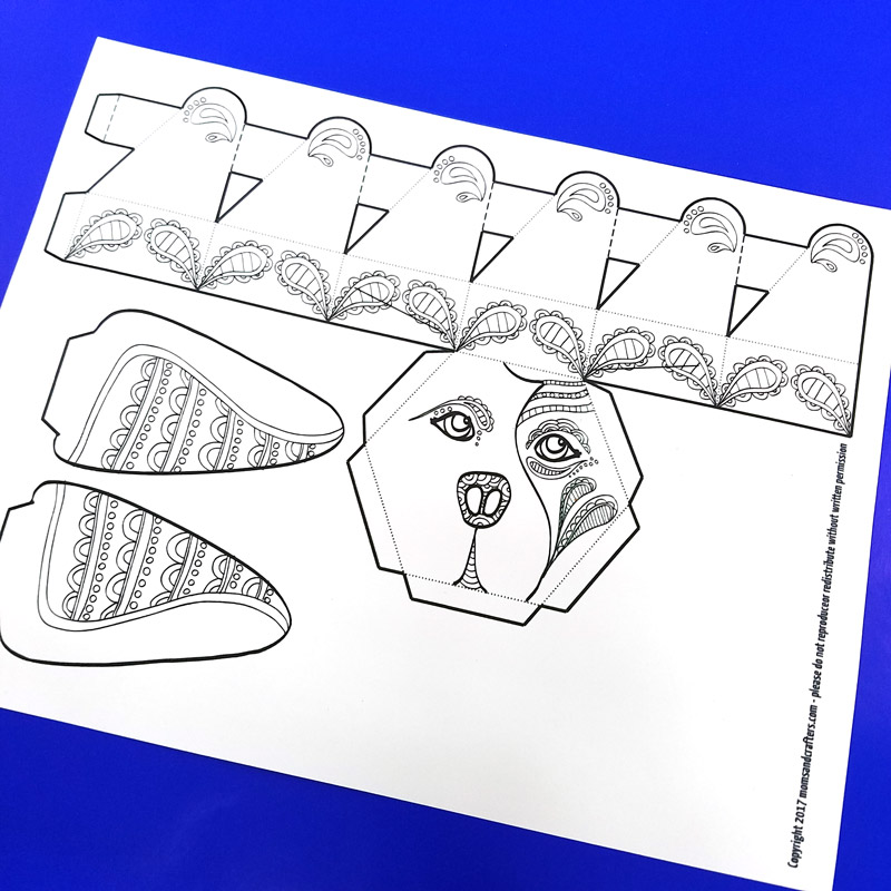 This adorable free printable dog coloring page for adults turns into a dog box for treats and small gifts! It's a cute way to gift money, or a jewelry box for dog lovers. You'll love this easy paper craft for adults! #adultcoloring #coloring #papercraft #papercrafts #diy #dogs