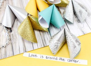 Make these super easy DIY paper fortune cookies - a super cool and simple (and cheap) DIY craft for teens and tweens. Perfect for new years eve celebrations or for any party or just for fun! #Newyearseve #newyear #papercraft #papercrafts #paper