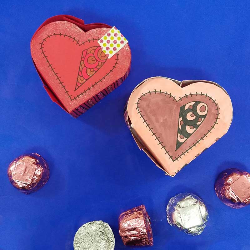 Grab the free printable template and craft this adorable heart box for Valentine's Day. This origami heart box is a sweet little DIY chocolate box and adult coloring page (perfect for big kids, tweens, and teens too!) for Valentines Day or your anniversary. #adultcoloring #papercraft #valentinesday