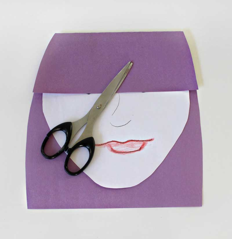 Step 4. Trim the edges of the paper so it is rounded and looks more like a head of hair.