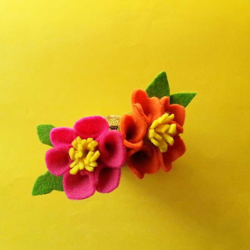 Felt flower template on yellow background