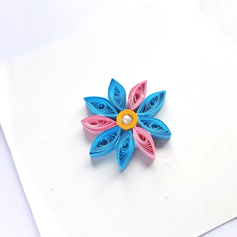 Repeat your pattern until your paper quilling flower shape is complete.