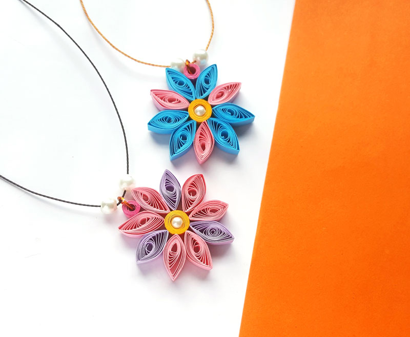 Paper quilling flower pendant paper quilled craft for beginners after youre done making this paper quilling flower pendant try it with other designs turn it into keyrings make smaller versions as earrings mightylinksfo