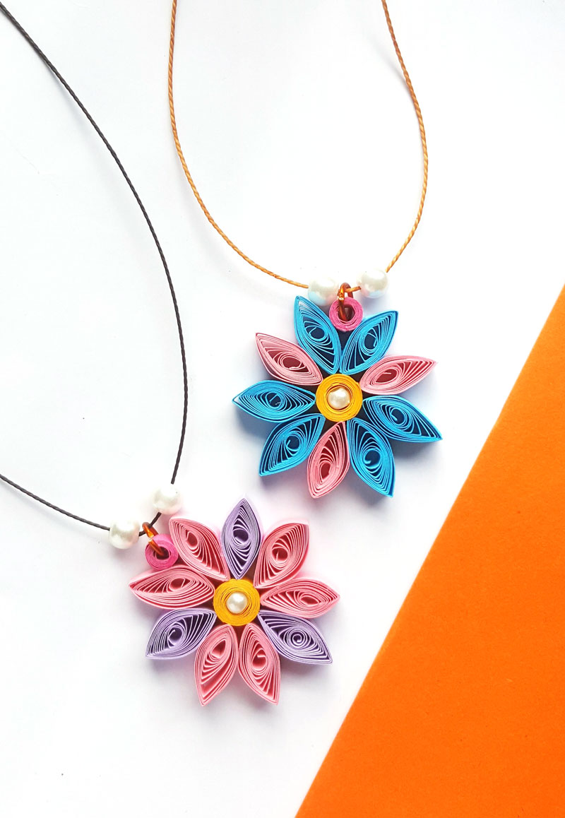 paper quilling flowers are an easy project for beginners and kids - and beautiful DIY jewelry to craft.
