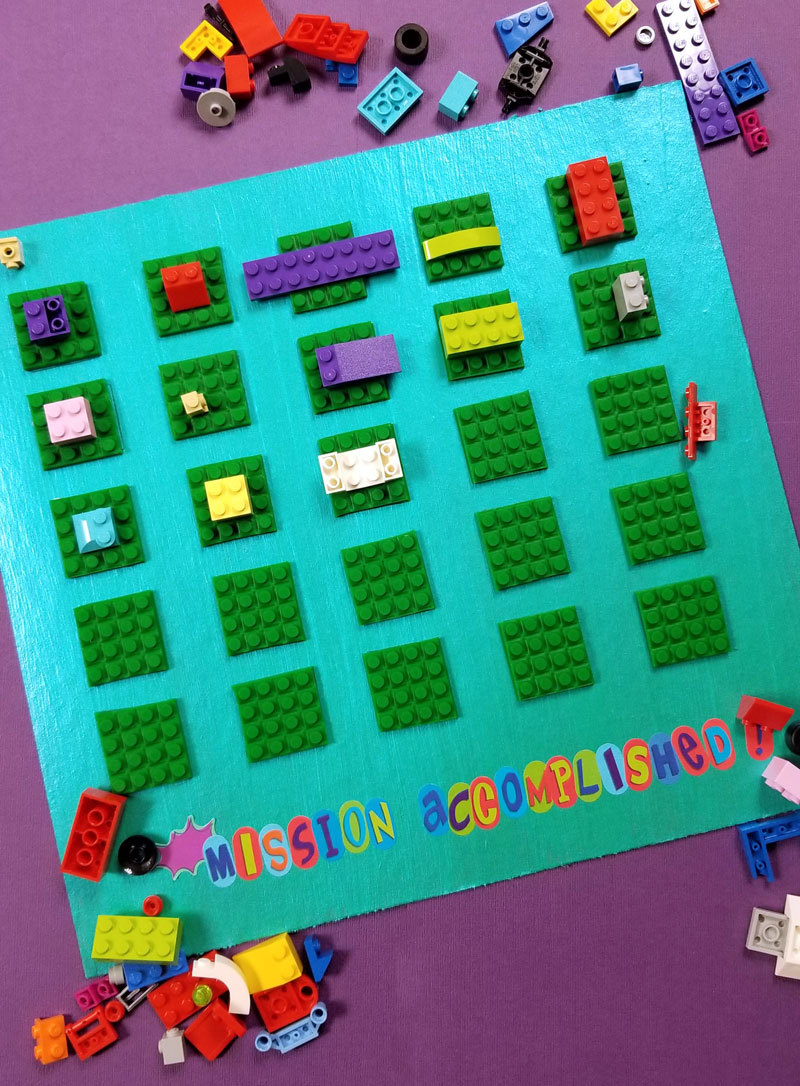 Click to find out how I made this super cool LEGO DIY reward chart for kids for my son to earn more bricks for his collection! This super cool LEGO craft has been working so well for us! #lego #legofan #kidscraft