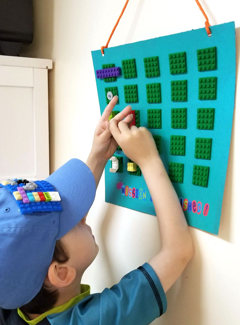 Allow your child to add his or her own bricks when they are earned to the DIY reward chart for kids.